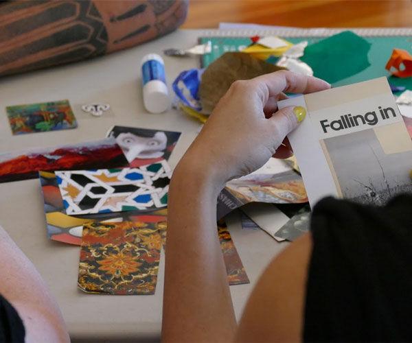 close up of a woman creating mixed media artwork